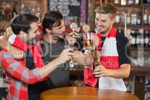 Happy friends enjoying in pub