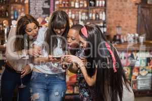Surprised woman looking in mobile phone