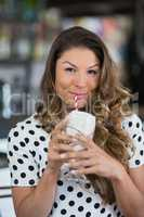 Portrait of young woman having drink