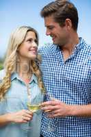 Young couple holding wineglasses