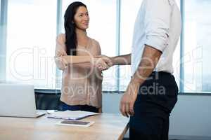 Business people shaking hands during meeting at office