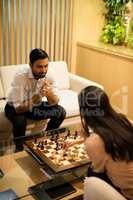 High angle view of business colleagues playing chess