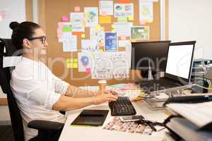 Businessman working at creative office desk