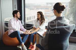Couple talking to a marriage counselor