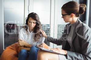 Counselor consoling unhappy woman