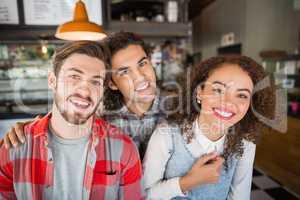 Portrait of smiling friends in restaurant
