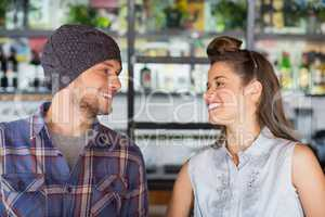 Friends looking at each other in restaurant