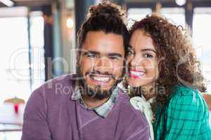 Portrait of cheerful young couple at restaurant
