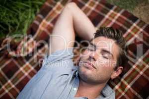 Man sleeping on blanket