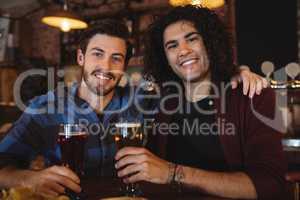 Friends having beer at bar counter