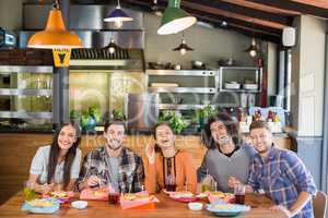 Friends enjoying food in restaurant