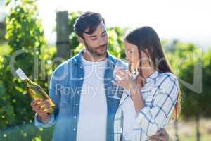 Man looking at girlfriend drinking wine