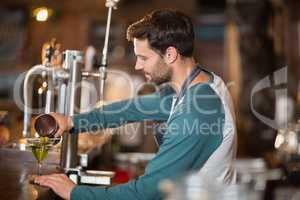Side view of bartender making drinks