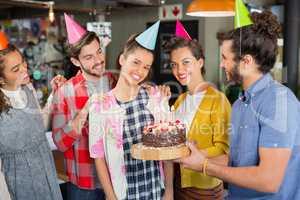 Friends celebrating woman birthday in restaurant