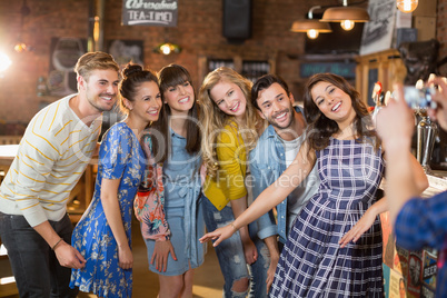 Group of happy friends posing in pub