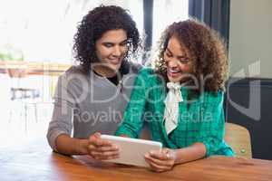Young friends using digital tablet