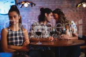 Jealous woman ignoring affectionate couple