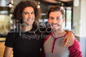 Portrait of smiling male friends in restaurant
