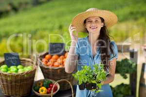Portrait of woman holding leaf vegetable