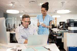 Smiling businesswoman talking with male colleague in office