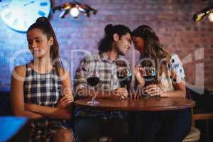 Jealous woman ignoring affectionate couple