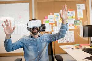Businessman experiencing virtual reality in office