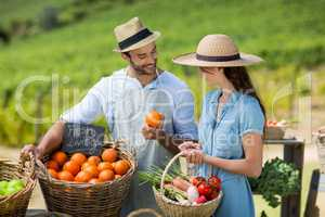 Woman buying fresh fruit from vendor