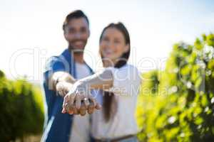 Happy couple holding hands on sunny day