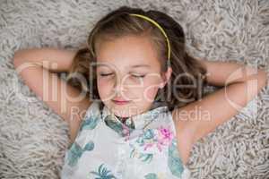 Girl sleeping on rug in living room