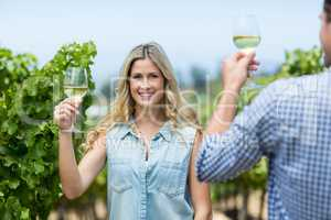 Happy woman with man holding wineglass