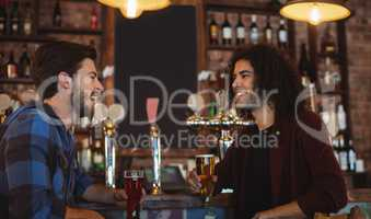 Friends having beer at bar counter
