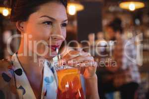 Young woman having cocktail drink