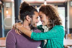 Young couple embracing in restaurant