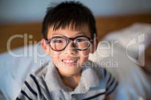 Boy in spectacles looking at camera