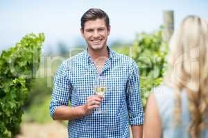 Portrait of young man holding wineglass