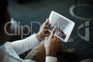 High angle view of businessman using digital tablet