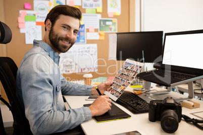Professional Designer Working At Desk