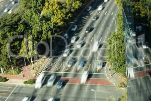 Blurred motion of cars moving on road