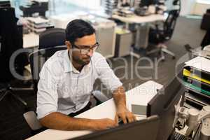 High angle view of businessman working on computer