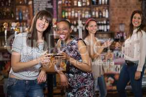 Portrait of happy females friends holding wineglasses