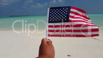 v01101 Maldives beautiful beach background white sandy tropical paradise island with blue sky sea water ocean 4k hand holding us american flag