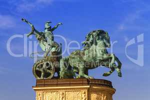 Statue representing War, a man holding a snake on a chariot, on a colonnade in Heroes Square or Hosok Tere, Budapest, Hungary.