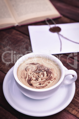 Cappuccino in a white cup with a saucer