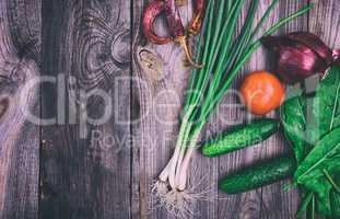 Fresh vegetables on a gray wooden surface