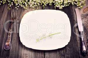 empty plate with iron vintage cutlery