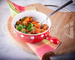 Baby carrots cooked with garlic, honey and parsley