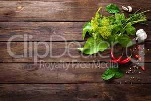 Herbs and spices on wooden culinary background, ingredients for cooking