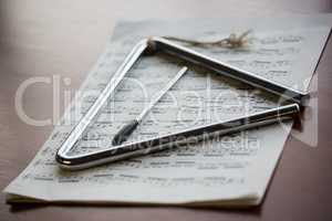 Close up of musical instrument with sheet music on table