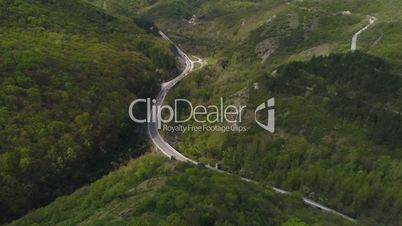 Drone footage of roud in mountain from above