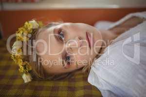 Portrait of woman lying down in van